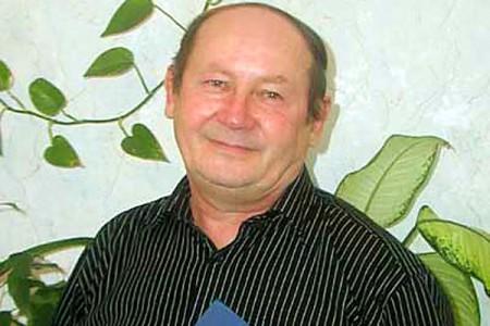 Евгений Петрович Карев.